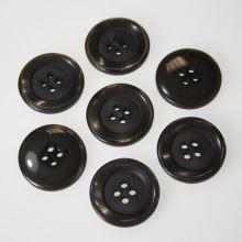 Knoflík šedohnědý K36-16, průměr 23 mm.