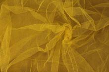 Tyl závojový žlutý š.180