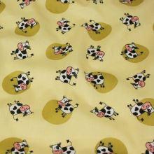 Bavlnené plátno žluté, kravičky, š.140