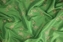 Taft zelený, béžová výšivka š.145