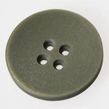Gombík svetlo šedý K44-4, priemer 28 mm.