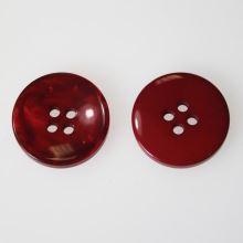 Knoflík červený K32-3, průměr 20 mm.