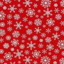 Plátno červené, bílé sněhové vločky, š.140