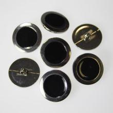 Knoflík stříbrnočerný K36-13, průměr 23 mm.
