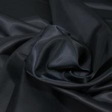 Podšívka temně modrá, šikmý proužek, š.150